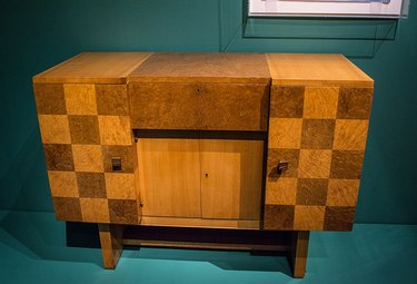 A 1930, Art Deco-inspired cabinet by Eugene Schoen that includes burl wood as a material