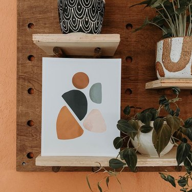 peg board decor featuring print
