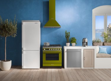 kitchen with blue wall and appliances in white and green