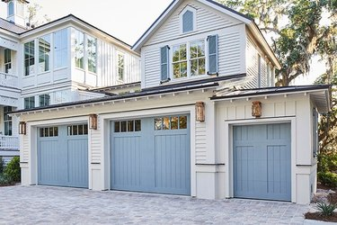 Light blue garage door colors on traditional white craftsman style home.