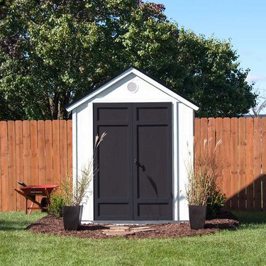 Contemporary shed in black and white with linear doors