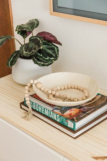 We love styling with stacks of books and potted plants.