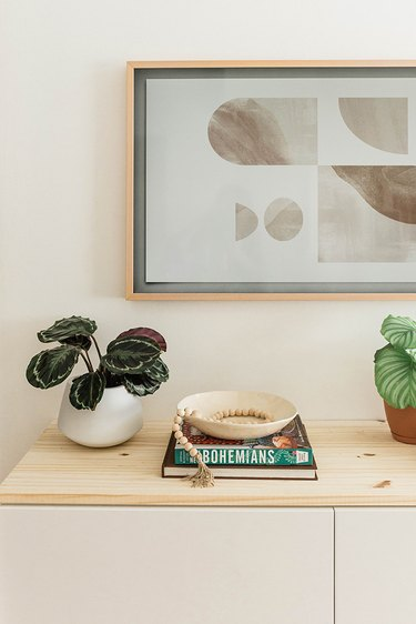This floating TV console is made by customizing an IKEA BESTA unit.