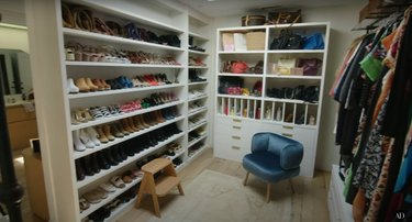hilary duff's closet with a shoe wall, ball wall, and wall of hanging clothes