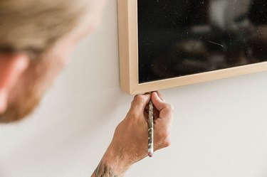 Lightly mark the corners of your television on the drywall.