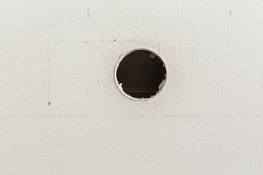 Drill the hole well inside the edges of where your TV will sit mounted on the wall.