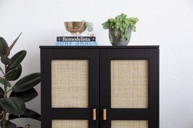 Black and cane IKEA Brimens cabinet