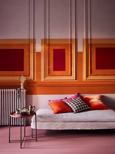 analogous colors in orange, pink, and red living room