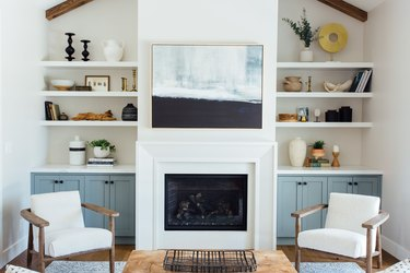 Simple white contemporary fireplace mantel by Michelle Lisac Interior Design