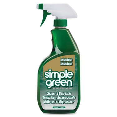 Green spray bottle with white nozzle