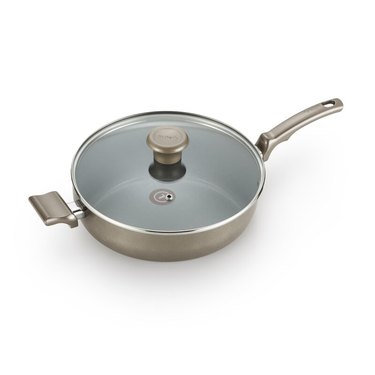 Champagne ceramic nonstick cookware pan with silver details and lid