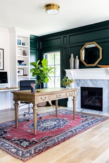 men's home office ideas with dark green paneled walls