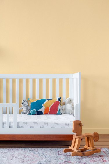 nursery with warm beige wall
