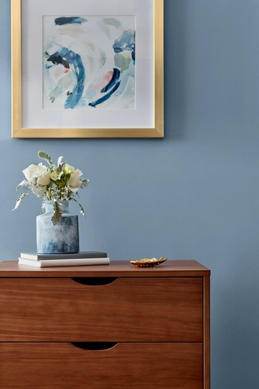 dresser in front of blue wall
