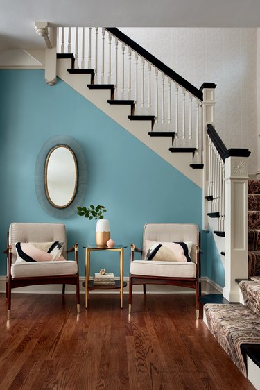 chairs and stairs with blue wall