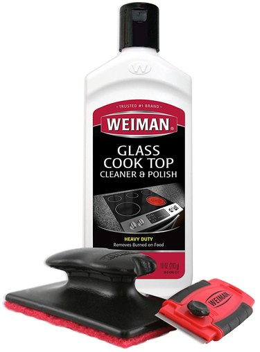 Cooktop cleaner bottle with scraper and pad