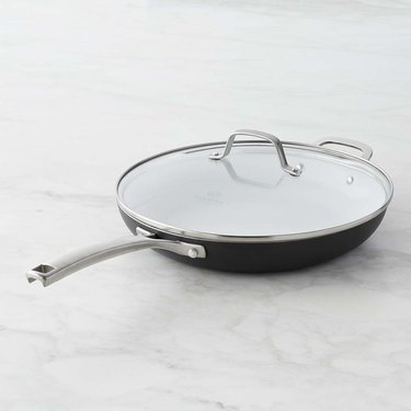 Black ceramic nonstick cookware pan with silver handle and lid