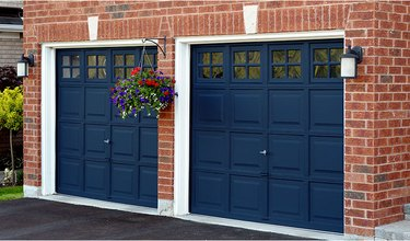 navy blue garage doors on brick house