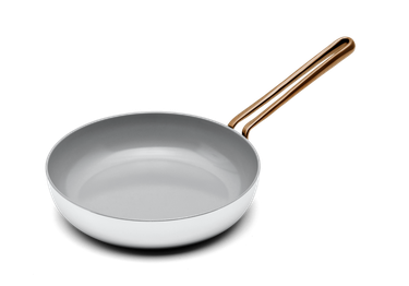 White ceramic nonstick cookware pan with rounded brass handle
