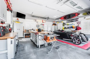 Garage work and hang out zone with Garage Wall Shelving Ideas