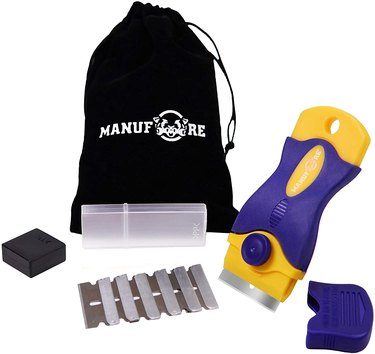 Purple and yellow surface scraper with carrying bag and extra blades