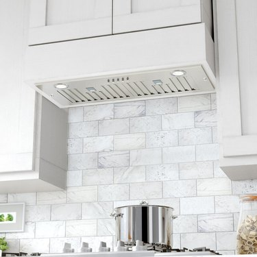 white kitchen with stove hood vent