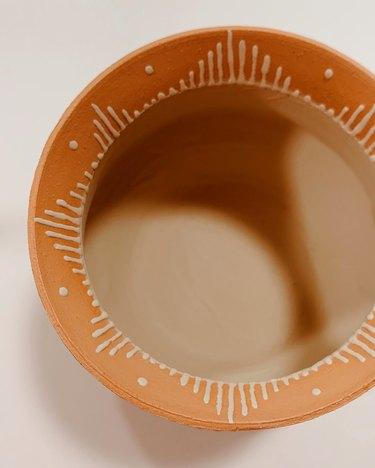 ceramic piece in terra cotta color