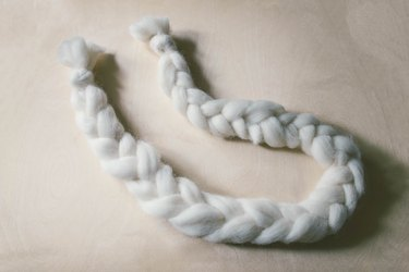 Braided strand of ivory wool