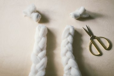Knots cut off ends of braided wool
