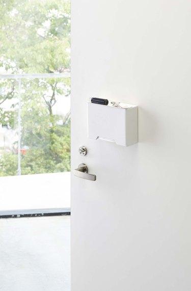 door with face mask dispenser