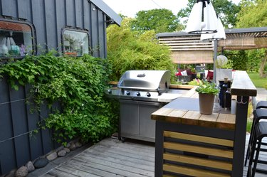 Outdoor kitchen with a stainless gas grill