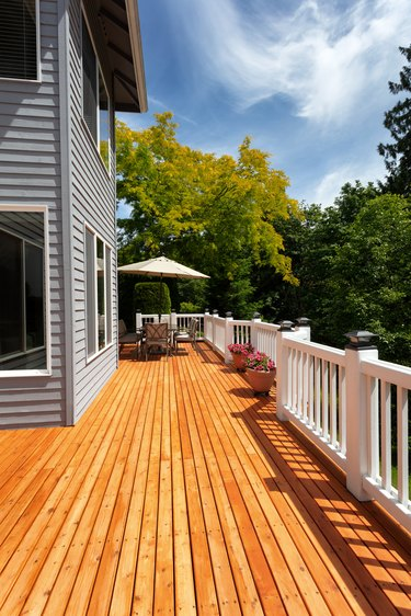 Brand new red cedar outdoor wooden patio during nice weather