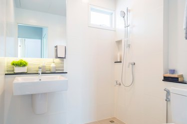 Bathroom picture with a basin with mirror and a shower.