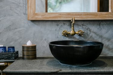 Black sink vintage copper faucet loft bathroom