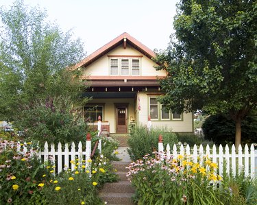 Bungalow House with White Picket Fence