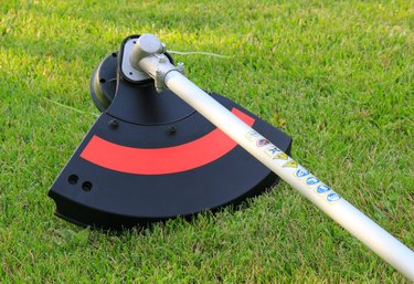 Weed trimmer in red and black on the grass