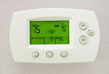 Programmable Digital Thermostat Showing 75 Degrees In Fahrenheit's