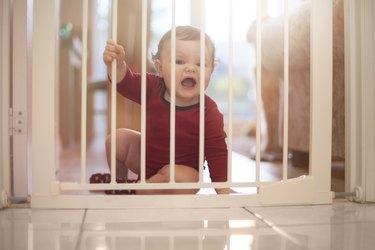 Baby boy upset at baby gate