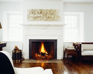 Front view of fire lit in living room fireplace
