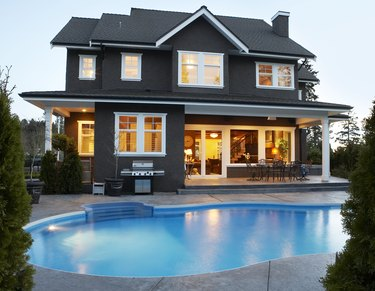 Canada, British Columbia, Surrey, back yard of house with pool at dusk