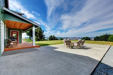 VIew of large concrete floor patio area at backyard