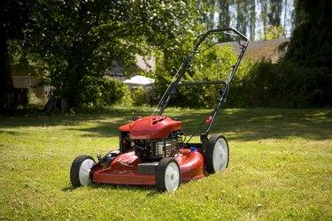 Lawn mower sitting alone on lawn