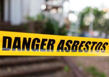 Danger Asbestos warning tape barrier