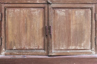 Old ancient grunge scratched dirty peeling paint vintage brown wooden cabinet texture abstract background
