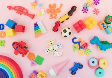 Background with different wooden and plastic kids toys with copy space