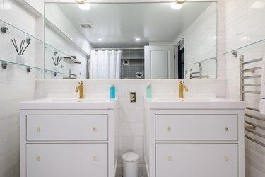 Straight on shot of double vanity sinks and mirror in stylish bathroom