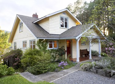 Exterior of cottage style house with front yard