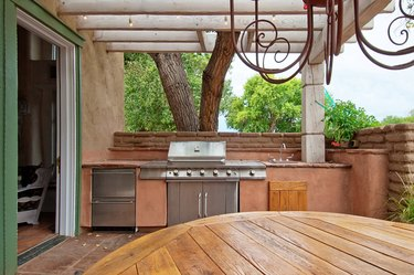 Outdoors Kitchen with Built-In gas grill on a deck