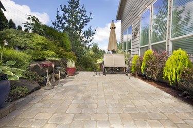 Backyard Paver Patio with Garden Accessories