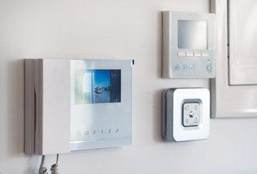 Close up wall with security alarm and video intercom